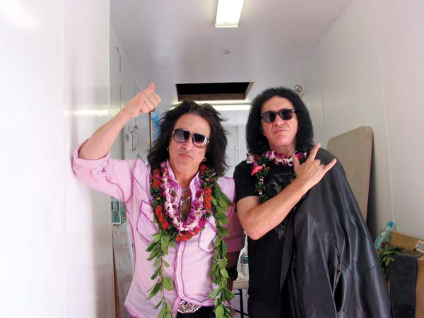 KISS frontmen Paul Stanley (left) and Gene Simmons give rocker salutes  at their Rock & Brews restaurant in Paia, which will offer complimentary menu items to veterans, active military and Maui's first responders on Saturday for Veteran's Day. The Maui News / CARLA TRACY file photo