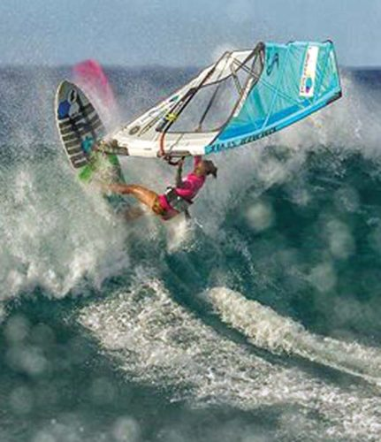 Sarah Hauser heads to a win in her Aloha Classic semifinal heat Friday at Hookipa Beach Park. -- International Windsurfing Tour / SI CROWTHER photo