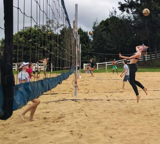 Chandler Cowell goes up for an attack as Amy Russell waits at the net during an Aloha Volleyball match Friday in Kula. Cowell and Ella Connor won the 18 open title, while Russell and Mileina Sniffen finished second. -- SCOTTIE ZUCCO photo