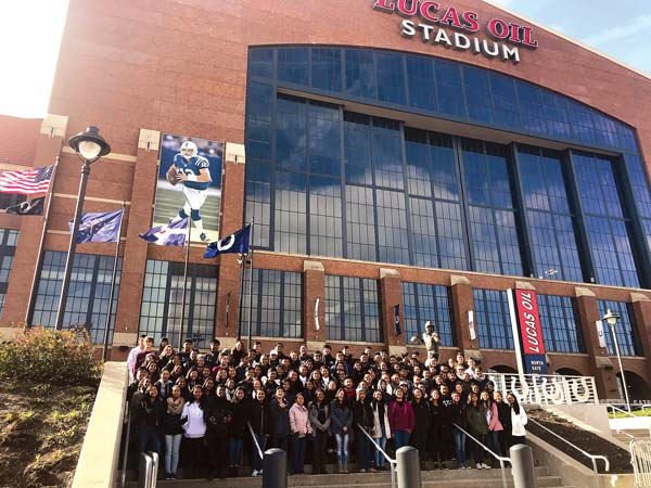 Members of the Maui High School Marching Band and Color Guard stand outside the Lucas Oil Stadium in Indianapolis earlier this week. The Sabers are performing and competing in the Bands of America Grand National Championships. -- Maui High School Band photo