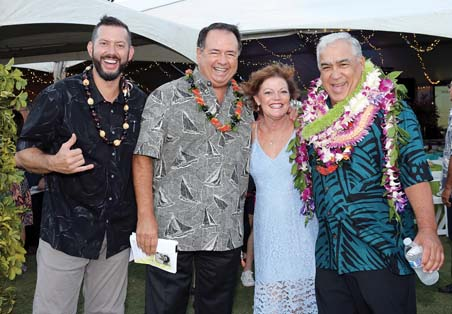 Event emcee Kanoa Leahey (from left), Maui Memorial Medical Center CEO Michael Rembis, Kristine Rembis and Tony Takitani are shown at the gala, which raised close to $195,000 for MMMC. -- John Henry Photography photo
