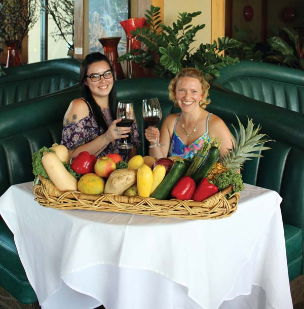 5 Palms hostess Hailee Pasatiempo (left) and Hartford Court Wines Sales and Marketing Manager Hailey Hartford-Murray toast to the Thanksgiving Day  feast at the Kihei restaurant, at which Hartford Family Wines such as Russian River Valley pinot noir and old-vine zinfandel will be featured. The Maui News / CARLA TRACY photo
