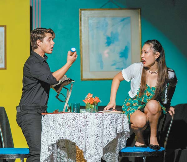 "Jaysen Giroux (left) and Lauryn Ige in a first date from hell in Baldwin Theatre Guild's production of ""Check, Please!"" concluding Sunday. Jack Grace photo"