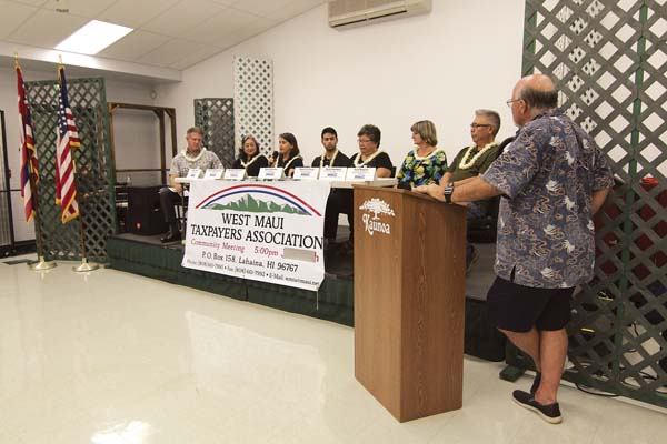 A panel that includes representatives from the county, nonprofits and developers talks about homelessness and housing Tuesday at the West Maui Senior Center. The Maui News / COLLEEN UECHI photo