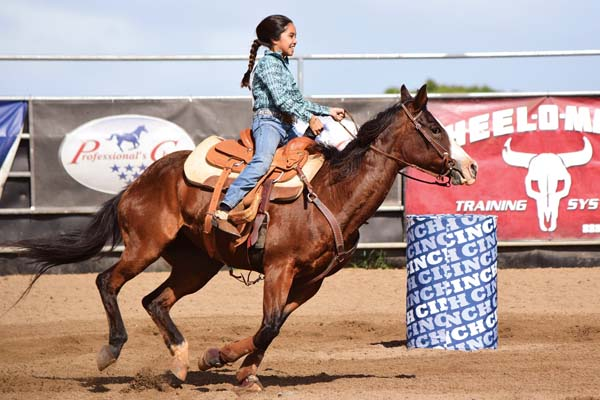 Bailey Sproat competes in barrels in the grades 3-5 division during last weekend's Hawaii High School Rodeo Association Maui shows at Kaonoulu Ranch in Makawao. Emy Ferguson photos
