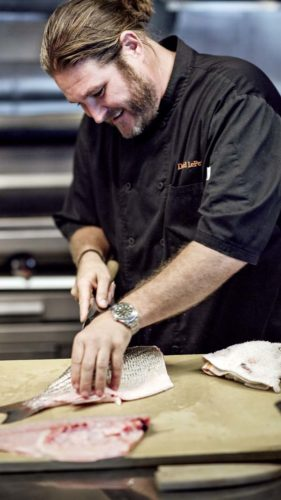 David LeFevre slices fresh fish at one of his Manhattan Beach restaurants. -- Arthur J photo
