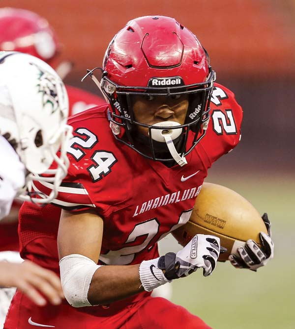 Elijah Ragudo carries the ball for Lahainaluna High School during a 75-69, seven-overtime win over Konawaena in the First Hawaiian Bank Division II State Football Championship title game Saturday at Aloha Stadium. -- MATT HIRATA photo