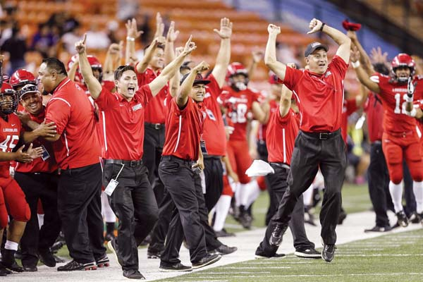 Lahainaluna coaches and players celebrate during the team's second straight win in the state final. -- MATT HIRATA photo