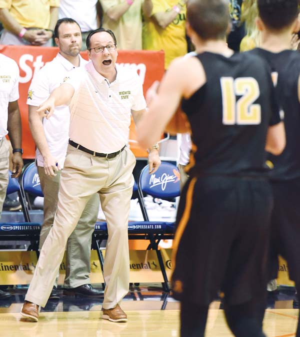 Wichita State coach Gregg Marshall calls out to his players in the first half.