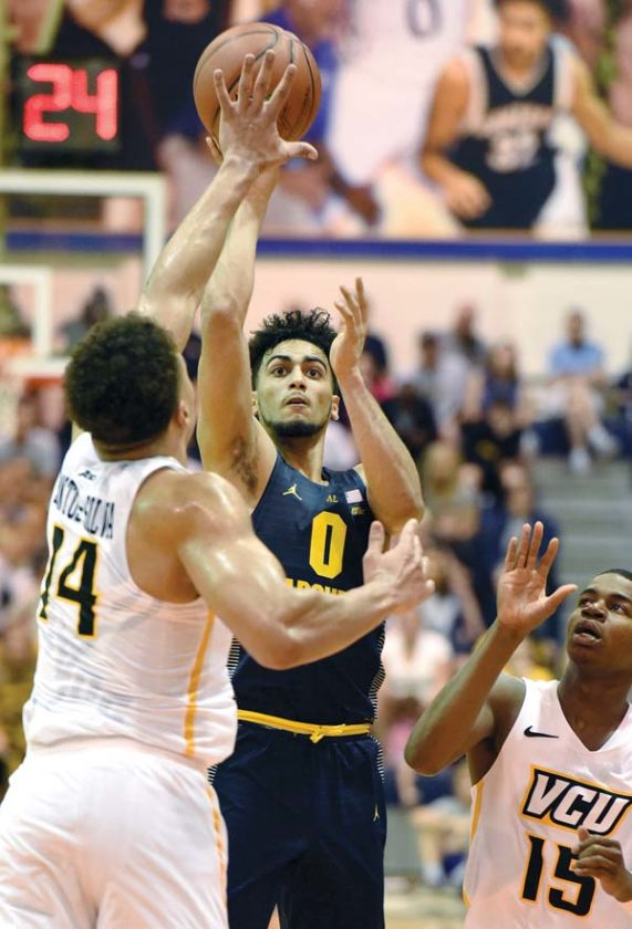 Marquette's Markus Howard puts up a shot between Virginia Commonwealth's Marcus Santos-Silva and Xavier Jackson during the first half of the Golden Eagles' 94-83 win over the Rams on Monday. The Maui News / MATTHEW THAYER photos