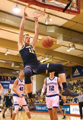Michigan's Moritz Wagner dunks during the first half of the Wolverines' 102-64 win over Chaminade on Tuesday. The Maui News / MATTHEW THAYER photo