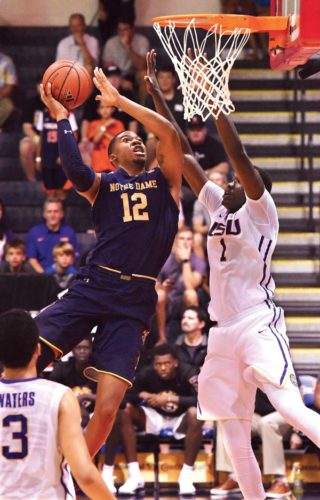 Notre Dame's Elijah Burns goes up for a shot as LSU's Duop Reath defends during the first half of a 92-53 victory for the Fighting Irish on Tuesday. The Maui News / MATTHEW THAYER photos