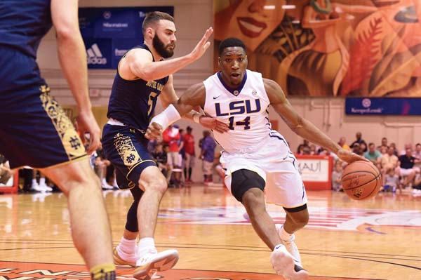 The Tigers' Randy Onwuasor is guarded by Matt Farrell of the Fighting Irish in the first half.