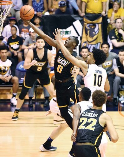 De'Riante Jenkins of Virginia Commonwealth soars toward the hoop as California's Justice Sueing defends during the second half of the Rams' 83-69 win over the Golden Bears on Tuesday. The Maui News / MATTHEW THAYER photo