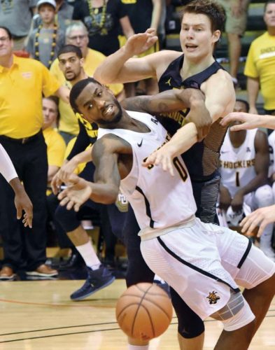 Rashard Kelly of Wichita State and Matt Heldt of Marquette compete for a loose ball in the second half. The Maui News / MATTHEW THAYER photo