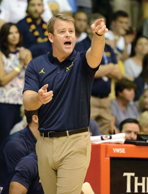 Marquette coach Steve Wojciechowski shouts to his team.