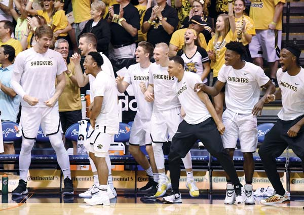 Wichita State players and fans celebrate in the second half.
