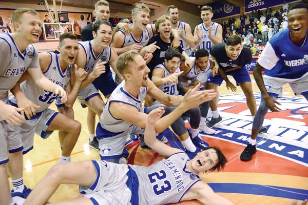Chaminade players celebrate after earning the program's eighth Maui Invitational victory, 96-72 over California in Wednesday's seventh-place game. The Maui News / MATTHEW THAYER photo