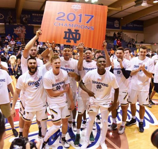 Notre Dame players celebrate after their 67-66 victory over Wichita State in the Maui Jim Maui Invitational championship game Wednesday at the Lahaina Civic Center. The Maui News / MATTHEW THAYER photos