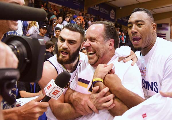 Notre Dame players Matt Farrell and Bonzie Colson interrupt coach Mike Brey's post-game television interview after the Fighting Irish defeated Wichita State in the championship game Wednesday.