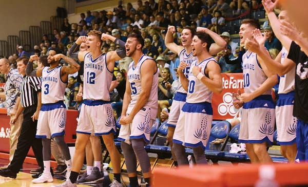 Chaminade players celebrate during the second half of their win over California in the Maui Jim Maui Invitational seventh-place game Wednesday at the Lahaina Civic Center. The Maui News / MATTHEW THAYER photos