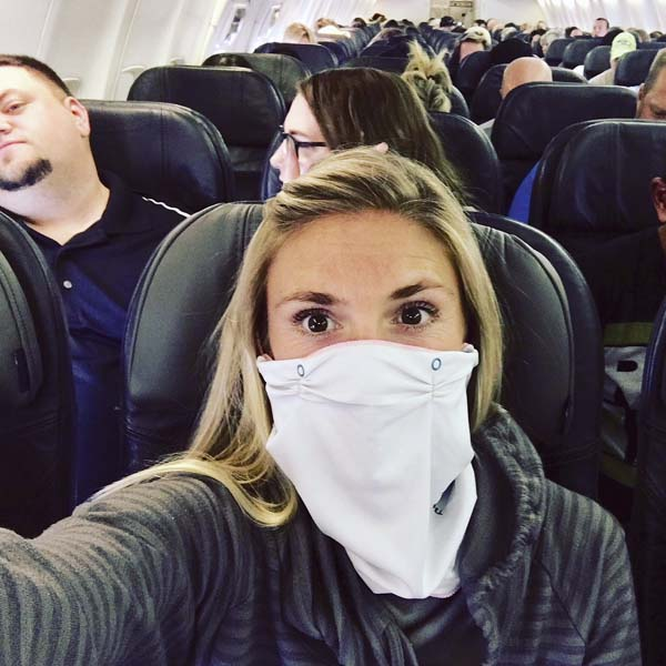 """Anytime she flies, Molly Palmer (pictured here) packs one essential item in her carry-on bag: The Barrier Method travel mask. """"I say 'bring it on' every time I fly now,"""" she said."""