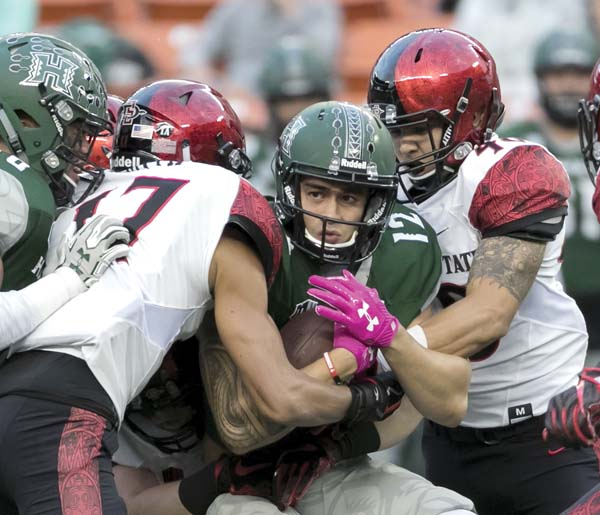 Keelan Ewaliko, shown being tackled during UH's loss to San Diego State last month, is one of 20 seniors playing their last game with the Rainbow Warriors today. -- AP file photo