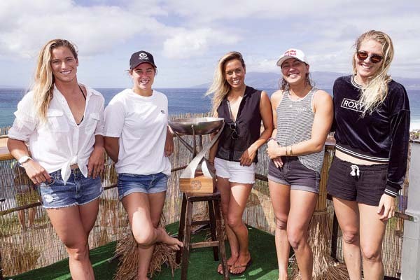 WSL world title contenders (from left) Courtney Conlogue, Tyler Wright, Sally Fitzgibbons, Carissa Moore and Stephanie Gilmore pose with the WSL trophy Friday at Honolua Bay. -- World Surf League / KELLY CESTARI photo