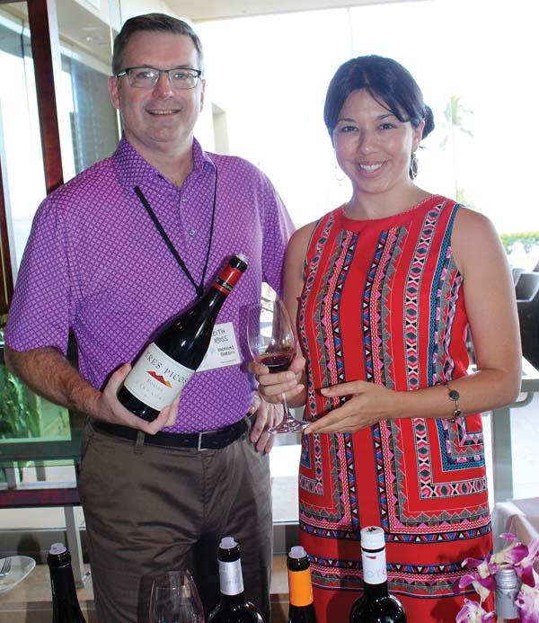 Keith Ross of Bodegas Borsao in Spain with Crissa Hiranaga of Four Seasons Resort Maui -- The Maui News / CARLA TRACY photo
