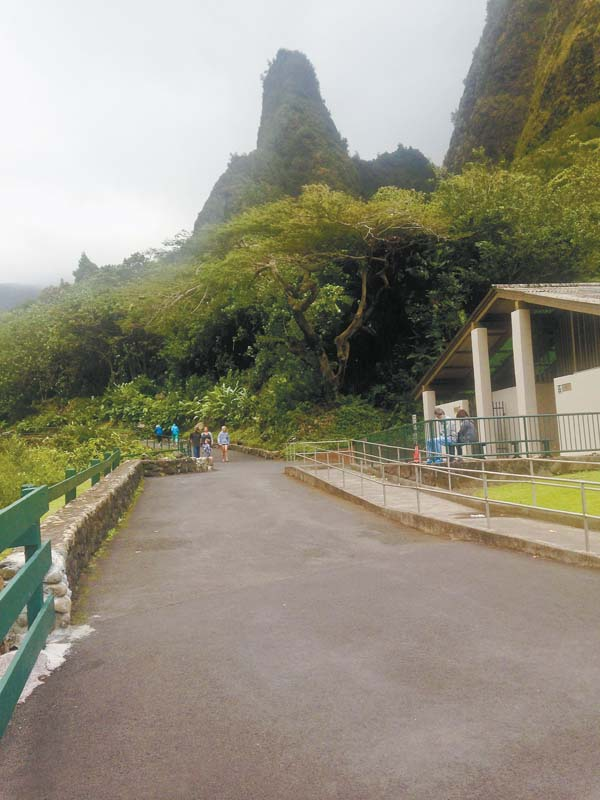 Visitors to the Iao Valley Monument walk down a pathway on Sunday afternoon. The park reopened last week after being closed for repairs and slope stabilization following massive damage from heavy rains in September 2016. There's a flash-flood watch in effect for Maui island. Weather forecasters caution that deep tropical moisture combined with decreased stability in the atmosphere could produce heavy rainfall and flash flooding. The Maui News / BRIAN PERRY photo