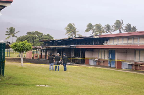 A classroom wing at Kahului Elementary School, shown on Monday being inspected, burned on Friday night. In 2010, another fire destroyed other classrooms adjacent to this wing.