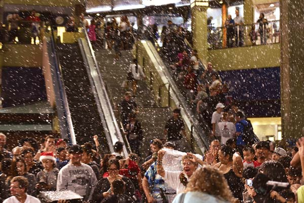 "Center court at the Queen Ka'ahumanu Center becomes a virtual winter wonderland during last year's ""Let it Snow"" event on Dec. 22. The ""snow"" is set to fall again."