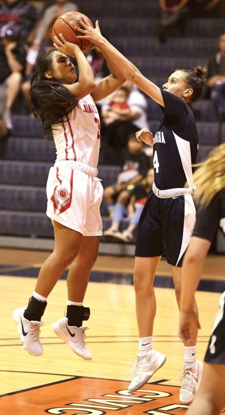 Lahainaluna's Tcleen Pahukoa battles for position with Kamehameha Maui's Mikiala Sniffen in the second quarter Tuesday.