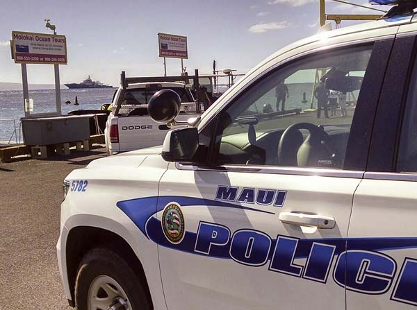 Molokai police respond to a group of residents protesting the arrival of a luxury yacht reportedly owned by Russian billionaire Yuri Milner on Friday morning at Kaunakakai Harbor. The owners decided not to come ashore after residents expressed concerns that Milner had not met with the community beforehand. WALTER RITTE photo