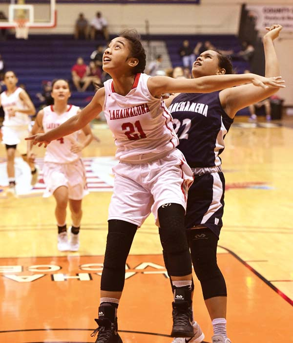 Lahainaluna's Tcleen Pahukoa battles for position with Kamehameha Maui's Mikiala Sniffen in the second quarter Tuesday at Lahaina Civic Center.