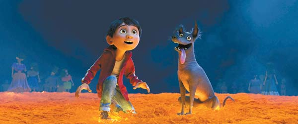"Anthony Gonzalez and Dante star in ""Coco."" Disney-Pixar photo via AP"