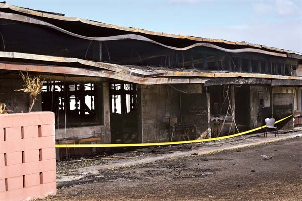 Kahului Elementary School's building F, which was torched in a suspected arson case Friday night, remains off-limits Wednesday afternoon. The school, which was slated to reopen to students today, will accept students again Monday. The Maui News / MATTHEW THAYER photos