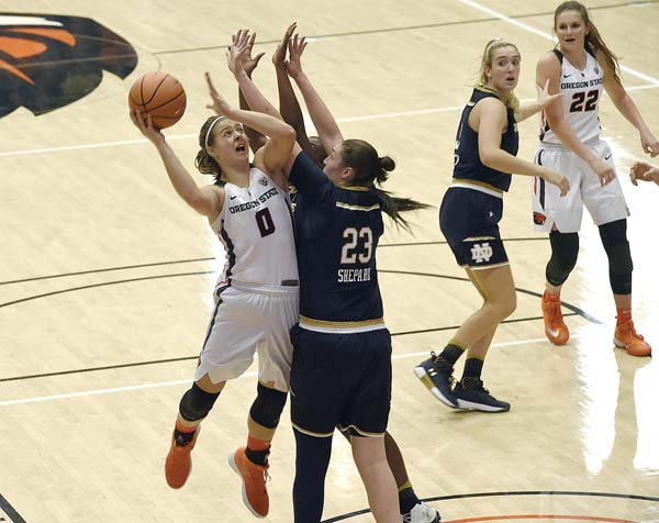 Oregon State's Mikayla Pivec shoots around Notre Dame's Jessica Shephard and Jackie Young during the Beavers' 72-67 loss on Nov. 19. Oregon State, Nevada, Utah State and Montana State play in the Maui Jim Maui Classic today and Saturday at War Memorial Gym. Albany Democrat-Herald via AP / Mark Ylen photo