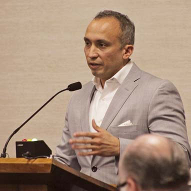 Carlos Gutierrez, vice president for state and local government affairs for the Consumer Healthcare Products Association, speaks in opposition to Maui County's proposed ban on sunscreen containing oxybenzone and octinoxate, which some scientists have linked to reef damage. Association officials said factors like climate change and runoff were more to blame for coral bleaching than sunscreen. --  The Maui News / COLLEEN UECHI photo