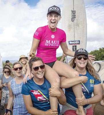 Stephanie Gilmore is carried off the beach after winning the WSL Maui Women's Pro on Friday. -- World Surf League / DAMIEN POULLENOT photo