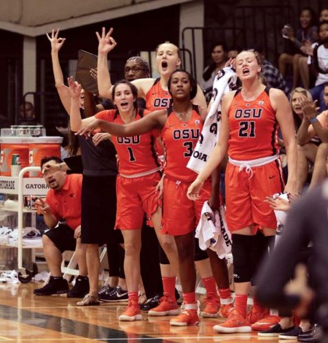 Players on the Oregon State bench celebrate a 3-pointer during the first quarter of the Beavers' 89-49 victory over Nevada in a Maui Jim Maui Classic game Friday night at War Memorial Gym. - The Maui News / CHRIS SUGIDONO photo