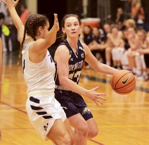 Montana State's Hannah Caudill looks to pass in front of Utah State's Eliza West in the third quarter of the Bobcats' 64-52 victory over the Aggies on Friday evening at War Memorial Gym. - The Maui News / CHRIS SUGIDONO photo