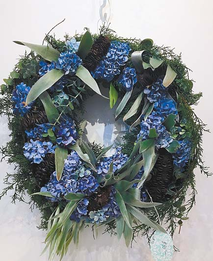 A fresh handmade wreath (above) is a highly coveted item available for purchase at the Hui No'eau gift shop. -- Photo courtesy Hui No'eau
