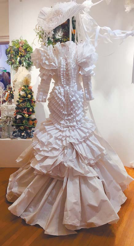 The 2017 Hui Holidays paper dress created by celebrated MAMo-designer Koa Johnson of Kojo Couture and Ry-n Shimabuku.  -- The Maui News / CATHERINE KENAR photo