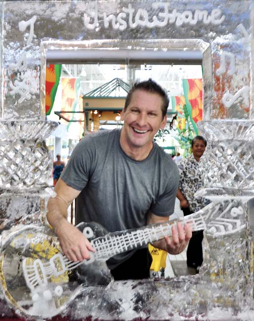 "Runner-up honors in the Lahaina Cannery Mall's annual International Ice Sculpting Competition went to Maui's Marc McDowell for his ""InstaFrame with Guitar & Pineapples."" He took home a second-place prize of $500."