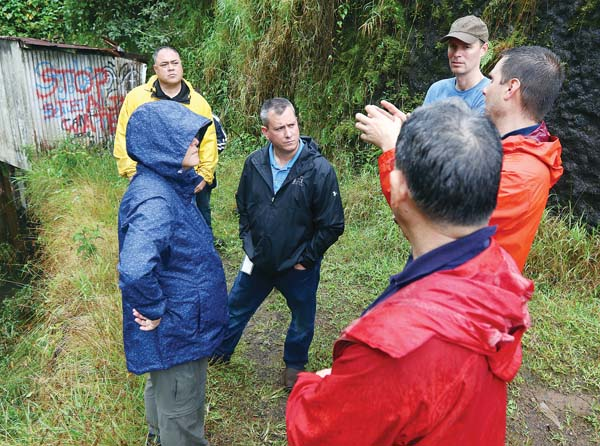 Officials from Alexander & Baldwin, Maui County, the Maui Tomorrow Foundation, a state Commission on Water Resource Management member and a state hydrologist gather near Kopiliula Stream on Wednesday in East Maui. - The Maui News / CHRIS SUGIDONO photo
