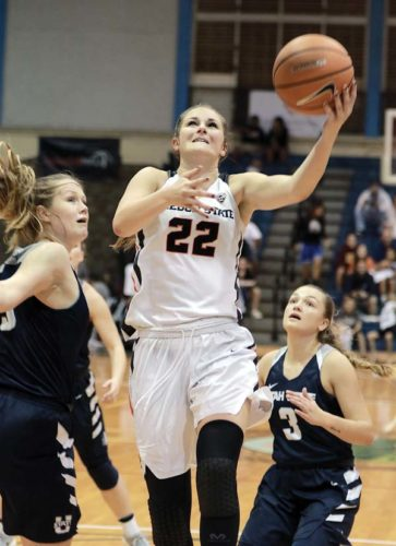 Oregon State's Kat Tudor goes up for a layup in front of Utah State's Olivia West (right) and Laura Daulton in the first quarter of the Beavers' 94-55 victory over the Aggies on Saturday night at War Memorial Gym. - The Maui News / CHRIS SUGIDONO photo