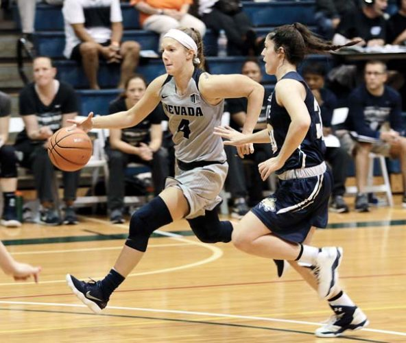 Nevada's Halie Bergman dribbles by Montana State's Rebekah Hatchard in the fourth quarter of the Wolf Pack's 67-53 victory over the Bobcats on Saturday at War Memorial Gym. - The Maui News / CHRIS SUGIDONO photo