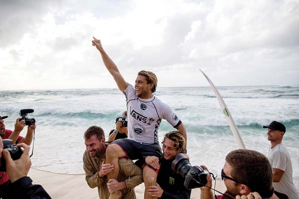 Conner Coffin celebrates as he's carried off the beach after winning the Vans World Cup on Saturday. -- World Surf League / TONY HEFF photo