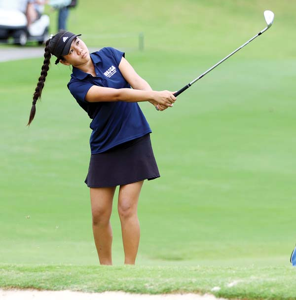 Jaelin Ishikawa of Pukalani hits onto the 10th green. - The Maui News / CHRIS SUGIDONO photo